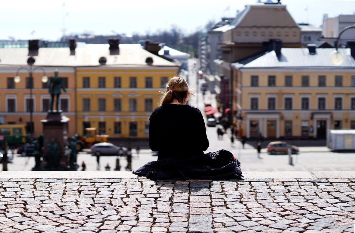 girl sitting senate square helsinki